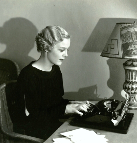 Gloria Stuart writing.